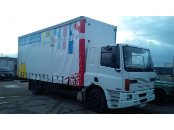 Left hand drive DAF 65 210 ATI Curtainsider lorry.