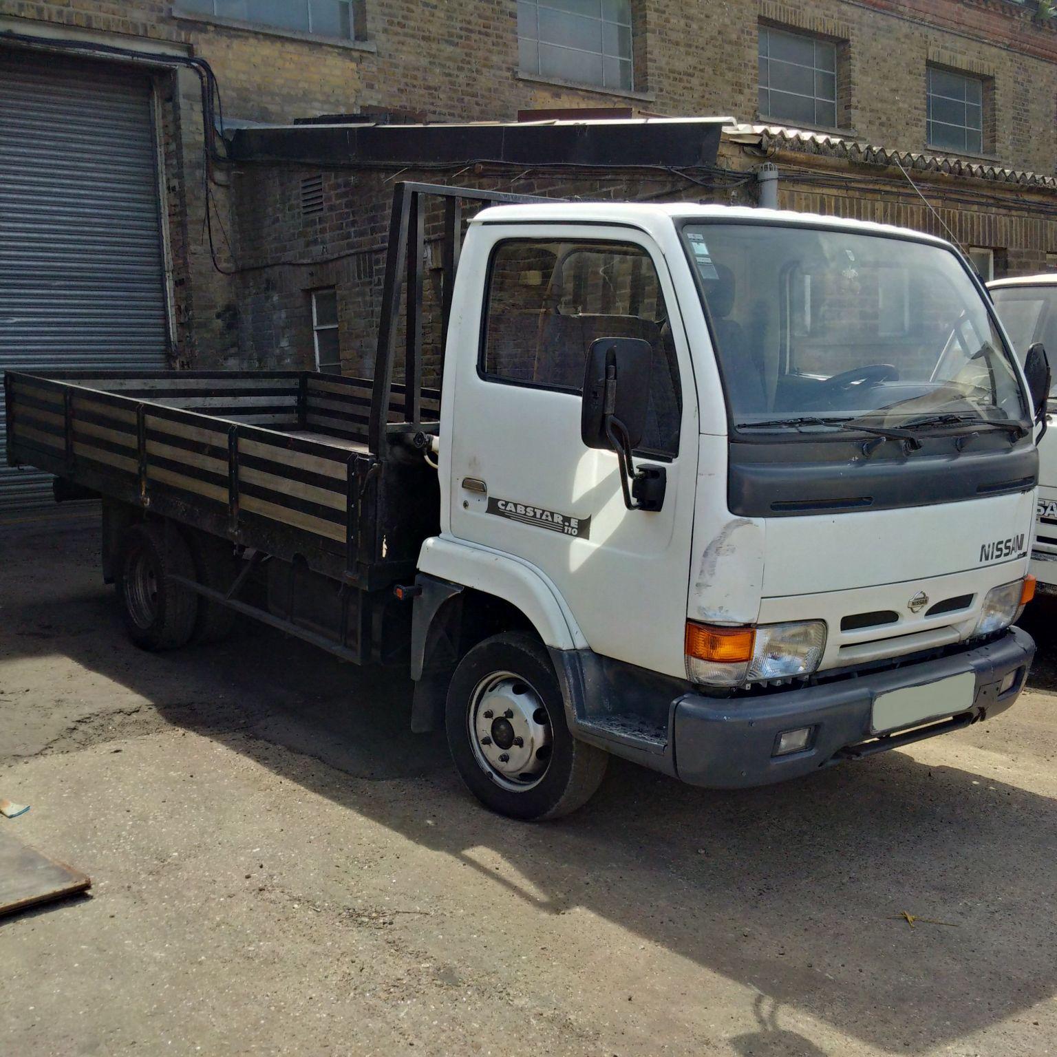 Left hand drive Nissan Cabstar E110 6 tyres truck.