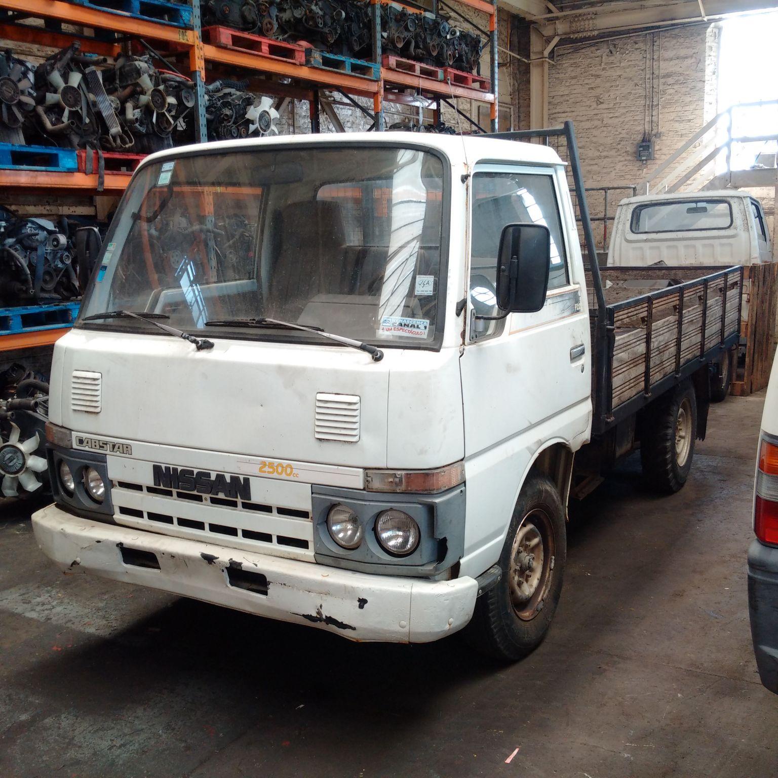 Left hand drive Nissan Cabstar TD25 single wheel pick up truck.