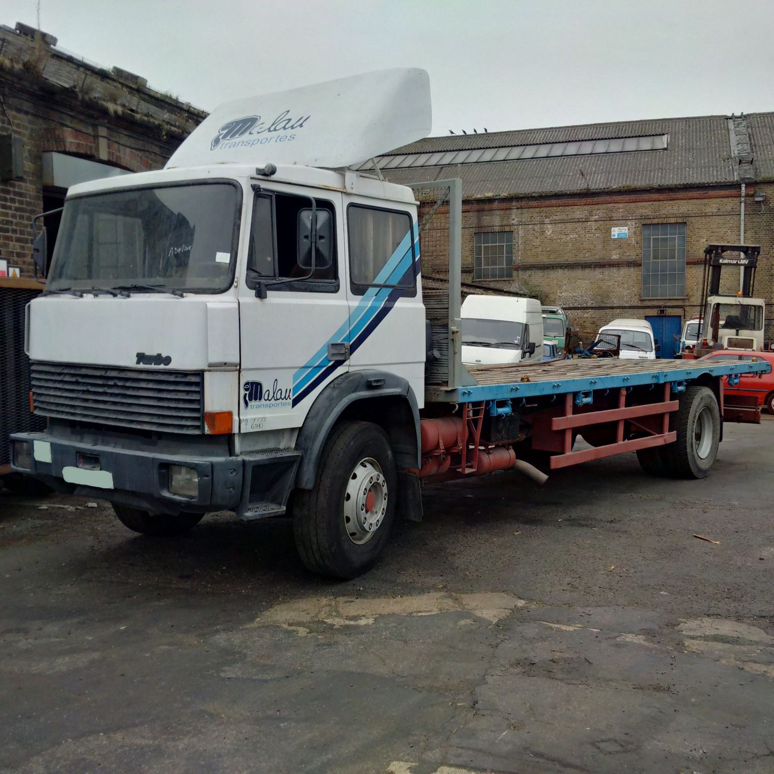 Left hand drive Iveco 175.24 19 Ton flat lorry with twist locks for containers.