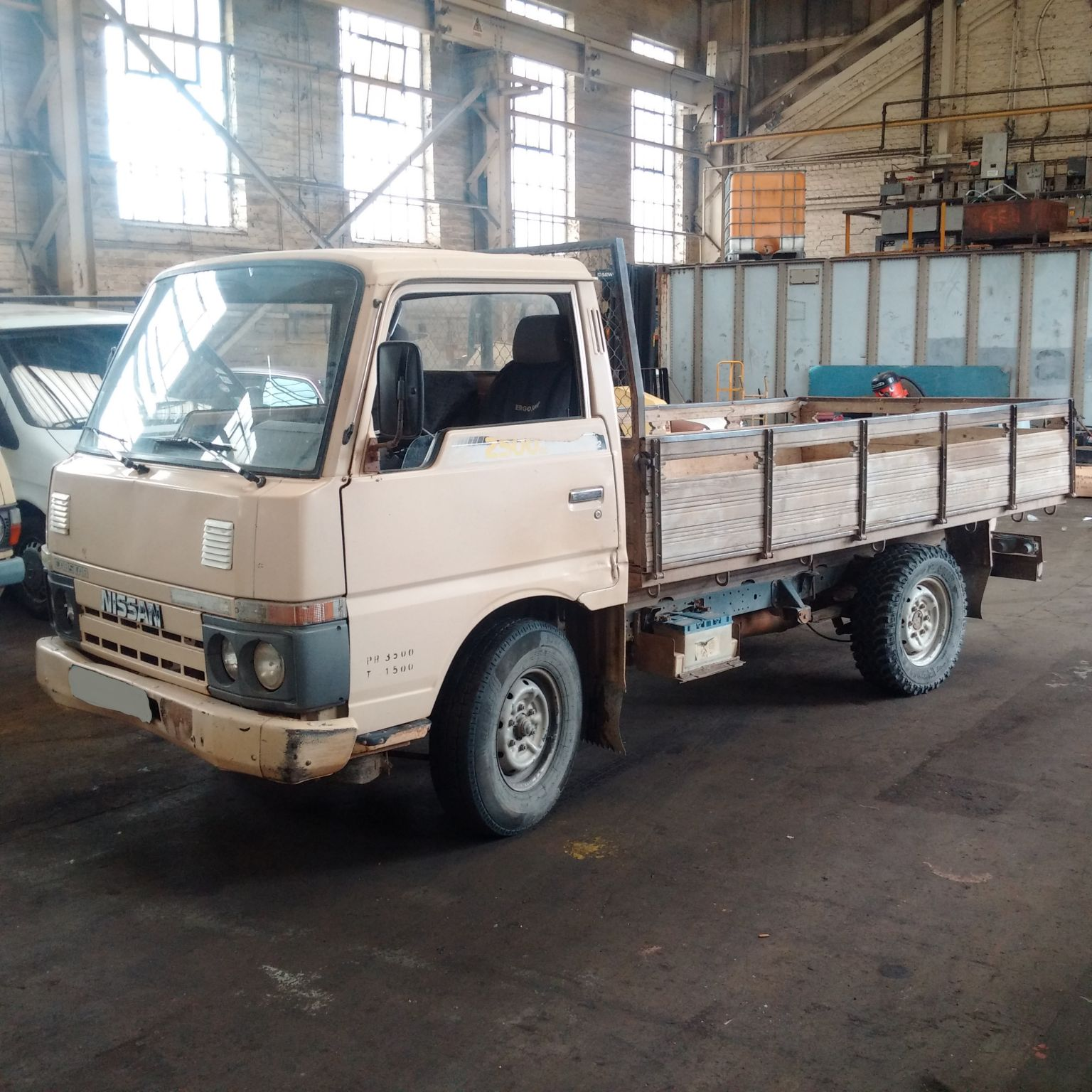 Left hand drive Nissan Cabstar F22 TD25 single wheel truck.