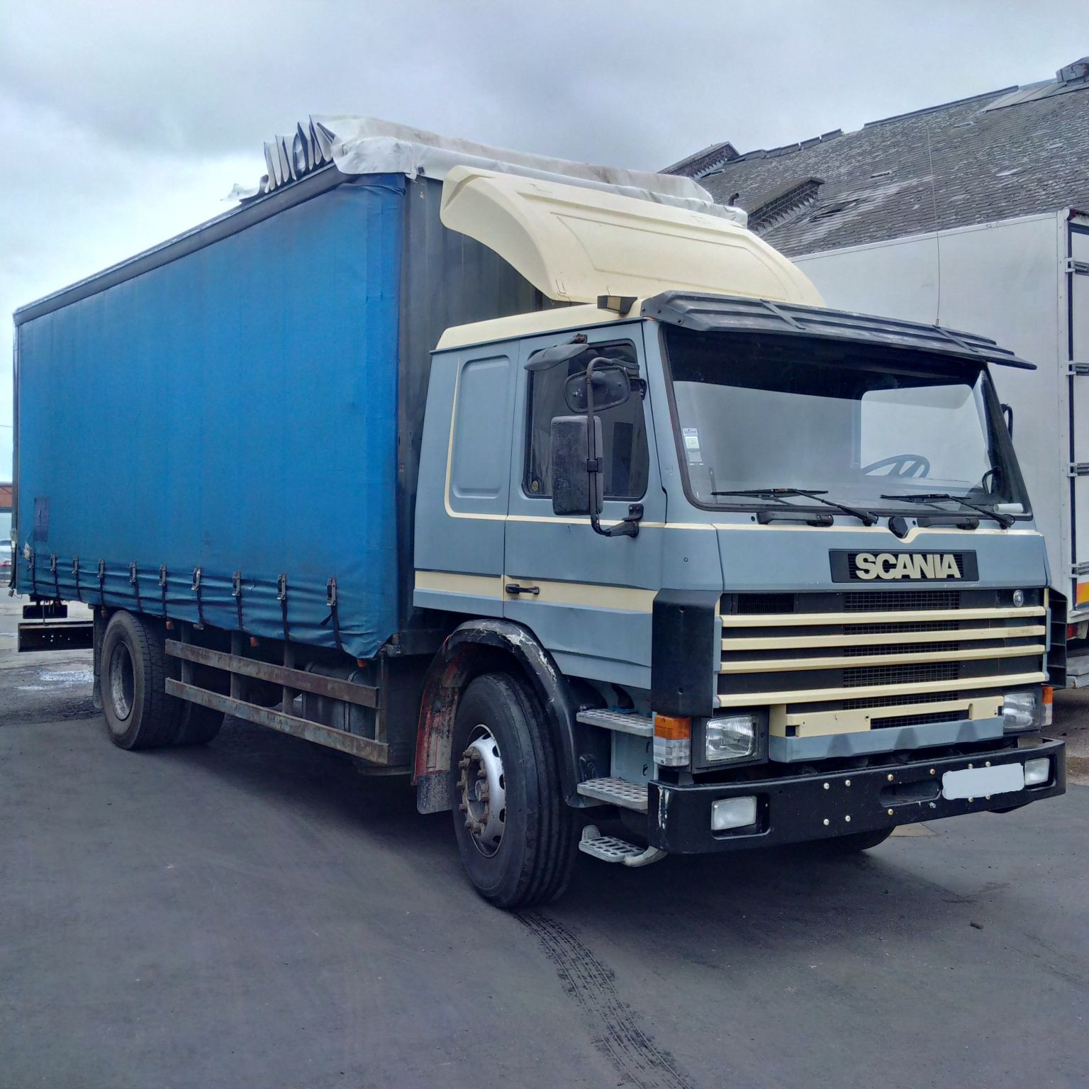 Left hand drive Scania 93M 230 4X2 19 Ton curtainsider.