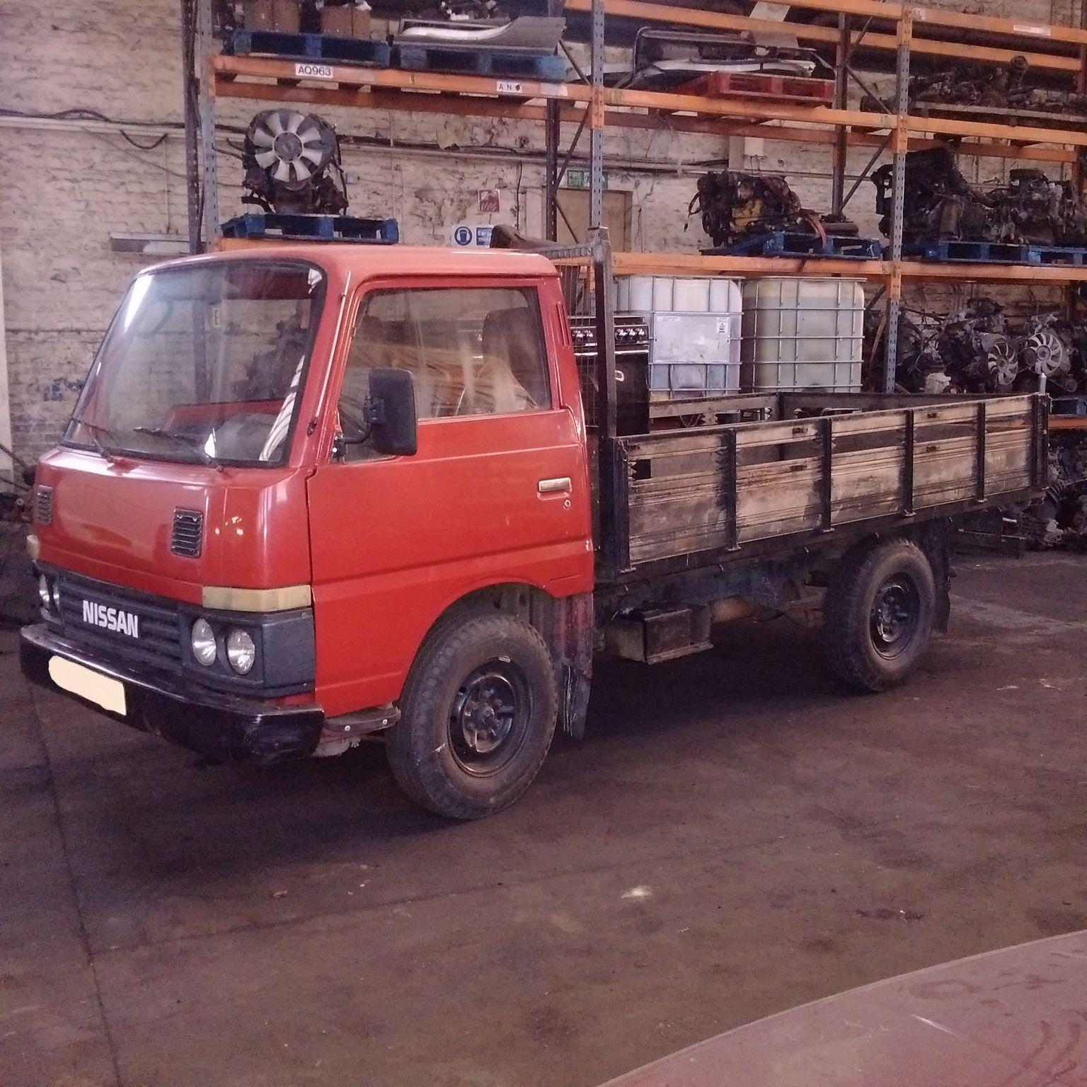 Left hand drive Nissan Cabstar TD25 3.5 Ton single wheel truck.