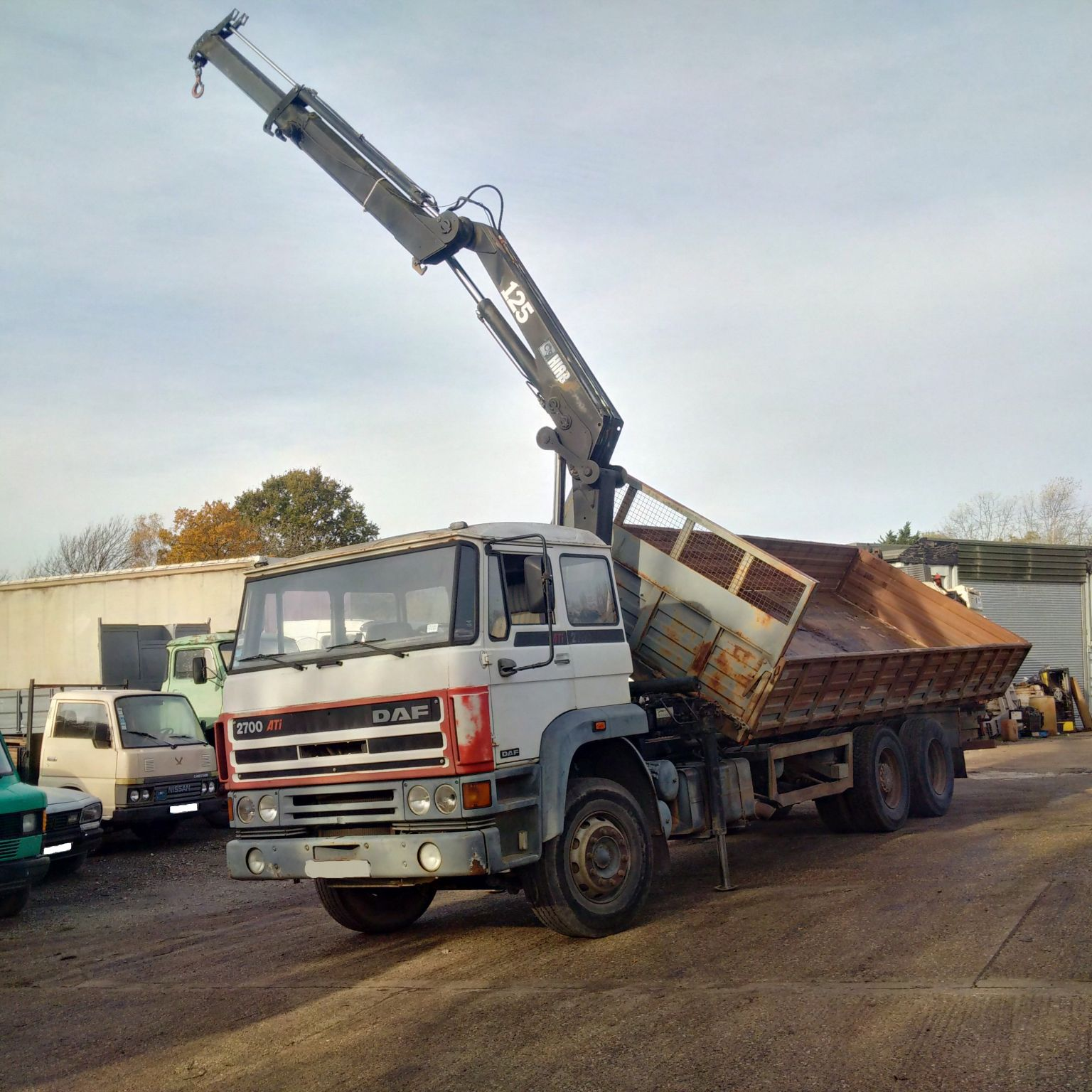 Left hand drive DAF 2700 ATI 10 tyres 26 ton tipper with HIAB 125 crane.