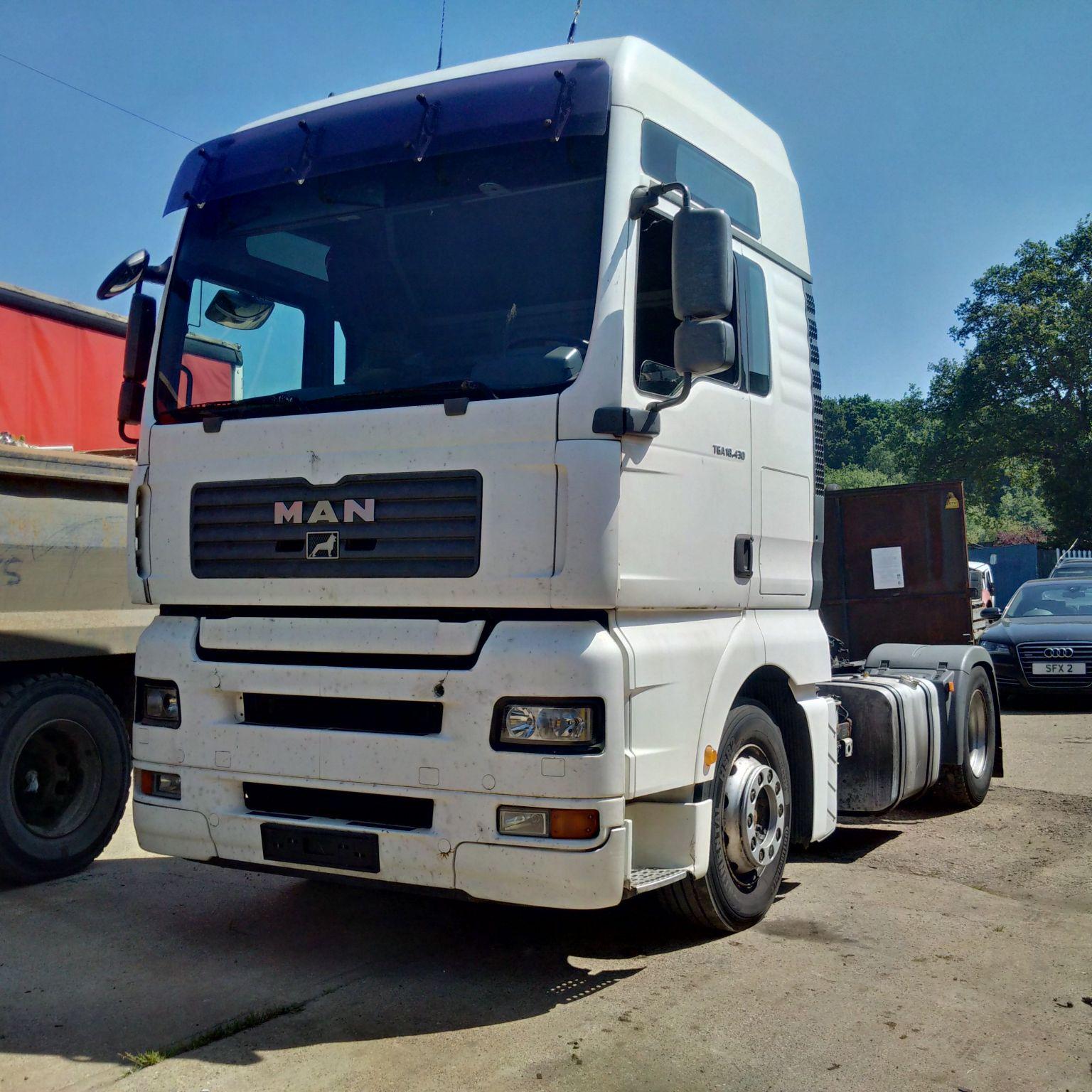 Left hand drive MAN TGA18.430 tractor unit.