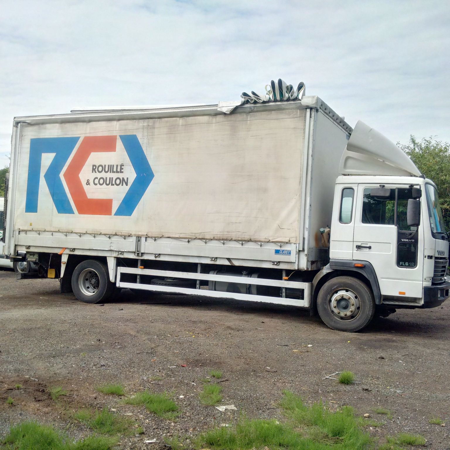 Left hand drive Volvo FL6.12 180 12 Ton curtainsider with tail lift.