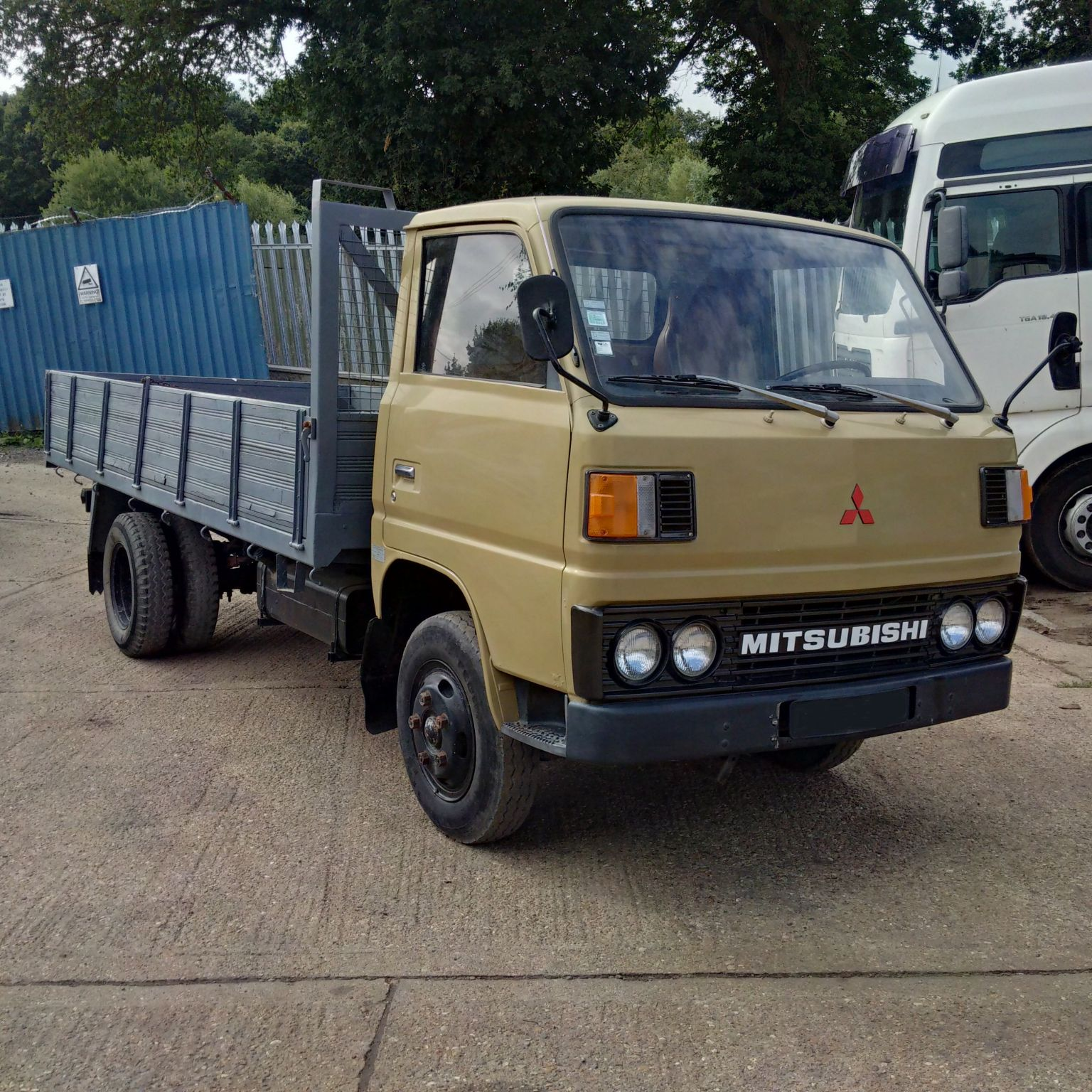 Left hand drive Mitsubishi Canter FE110 2.7 diesel 6 tyres truck.