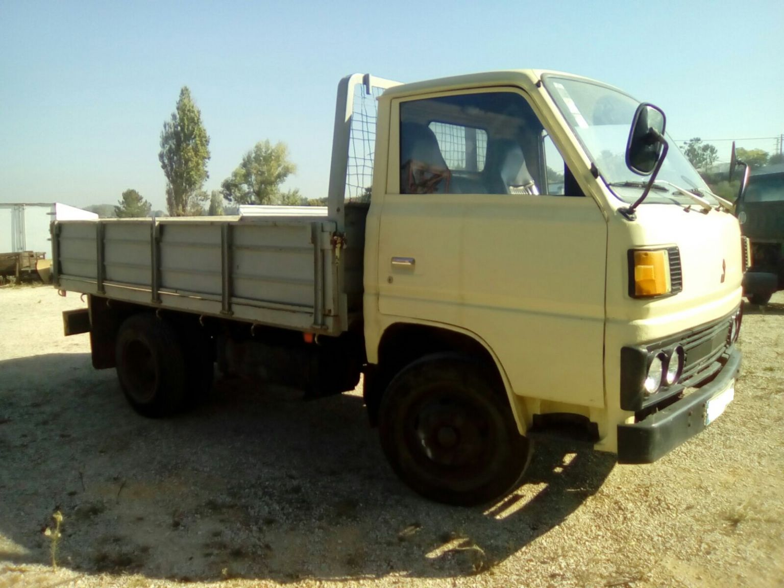 Left hand drive Mitsubishi Canter FE110 2.7D 6 tyres truck.