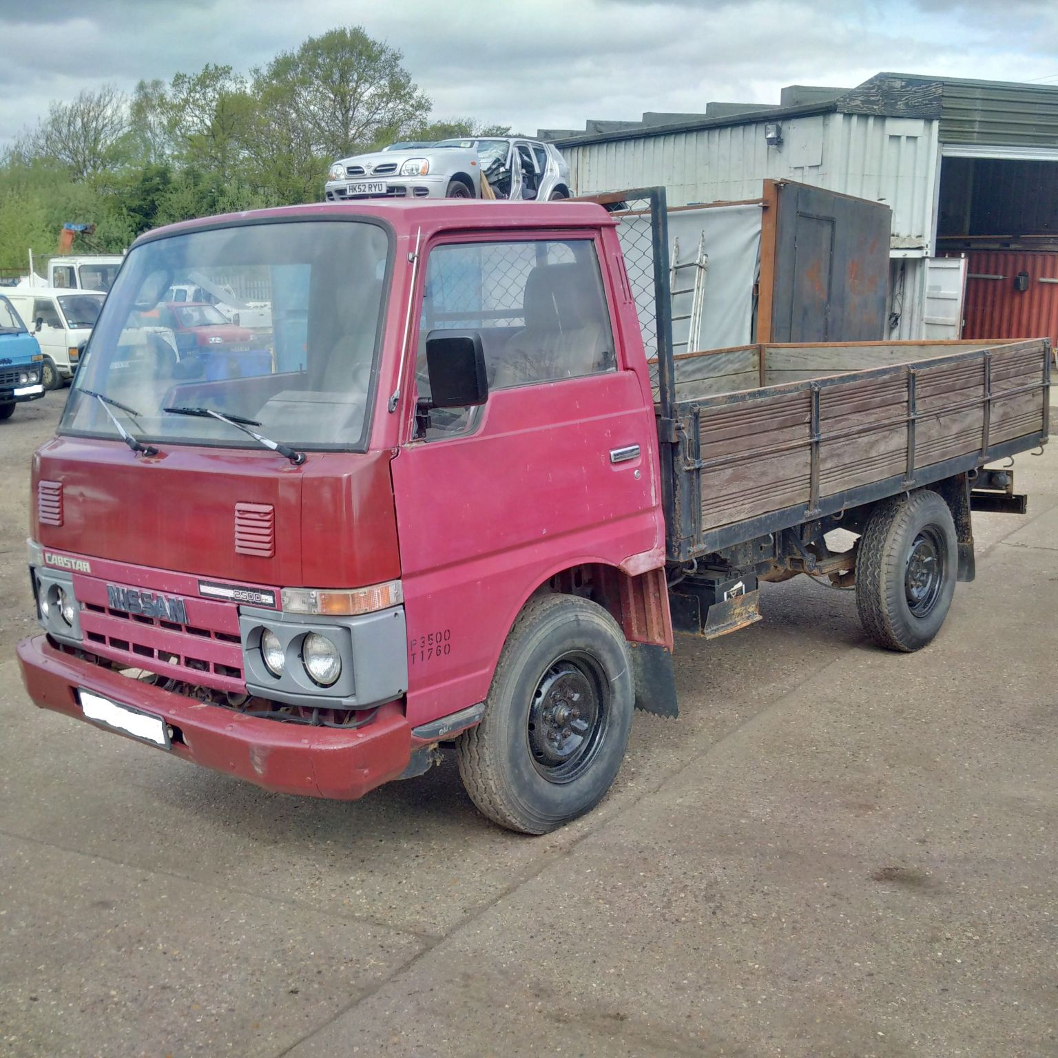 Left hand drive Nissan Cabstar TD25 2.5 D pick up truck.