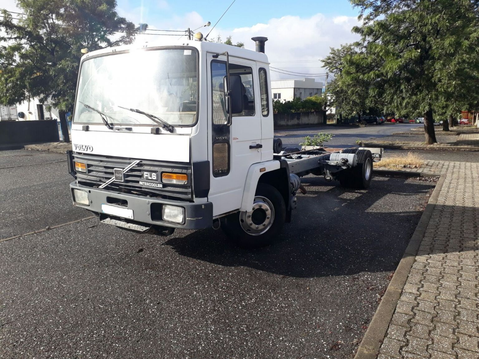 Left hand drive Volvo FL613 chassis cab truck